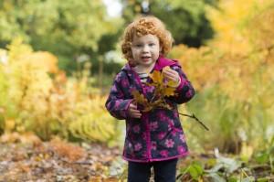 Little Zoe enjoying the leaves!