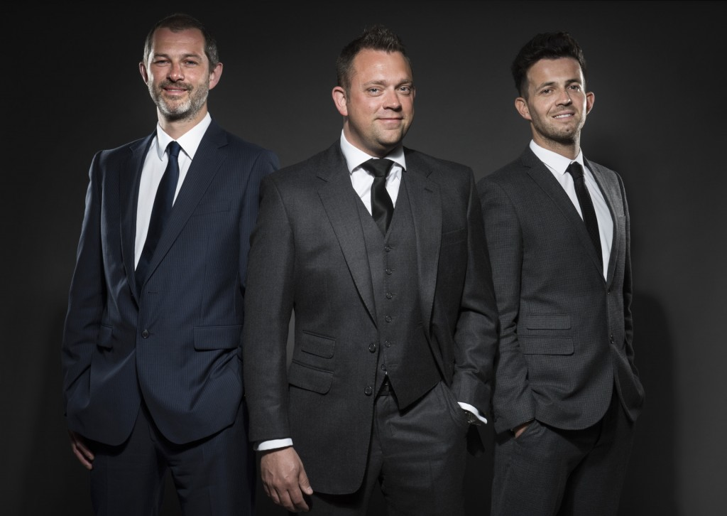 Two men in grey suits and ion in blue... but not for long!
