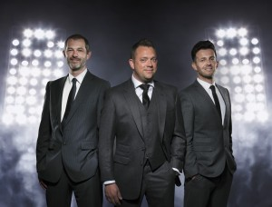 There. Not all business shots of three men in suits have to be the same!